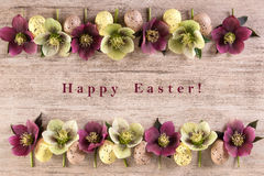 Предпосылка счастливая пасха пасхи Расположение цветков весны на ретро предпосылке Стоковое Изображение RF