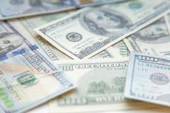 Предпосылка с американцом денег 100 счетов доллара Стоковое Фото