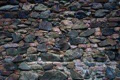 предпосылка сделала каменную белизну стены текстуры камней Старые блоки утеса в старом средневековом кирпиче Стоковые Изображения