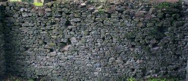 предпосылка сделала каменную белизну стены текстуры камней Старые блоки утеса в старом средневековом кирпиче Стоковое фото RF