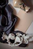 Предпосылка с купидоном на голубом шелке Стоковая Фотография RF