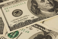 Предпосылка с долларовыми банкнотами американца 100 денег Стоковое фото RF