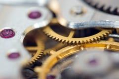 Предпосылка с cogwheels металла clockwork Макрос Стоковые Изображения RF