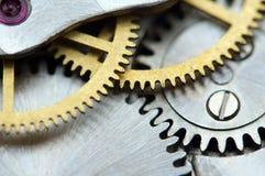 Предпосылка с cogwheels металла clockwork Стоковые Изображения RF