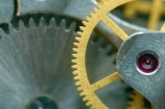 Предпосылка с cogwheels металла clockwork Стоковая Фотография
