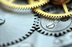 Предпосылка с cogwheels металла clockwork Стоковые Фото