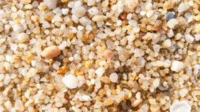 Предпосылка текстуры грубозернистого песка Стоковая Фотография