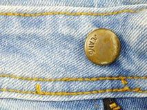 Предпосылка текстуры кнопки джинсов Стоковое Изображение RF
