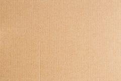 Предпосылка текстуры конспекта листа бумажной коробки Брайна Стоковая Фотография