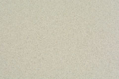 Предпосылка текстуры пляжа с белым песком Стоковое Фото