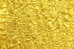 Предпосылка текстуры сусального золота Стоковая Фотография