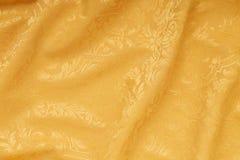 Предпосылка текстуры штофа золота флористическая волнистая Стоковая Фотография RF