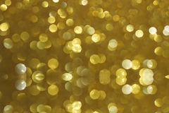 Предпосылка текстуры bokeh яркого блеска золота Стоковое Изображение