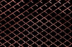 Предпосылка темноты - красной текстуры сети металла Стоковая Фотография RF