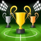 Предпосылка футбола с светами светловины и трофеем 3 наград Стоковая Фотография RF