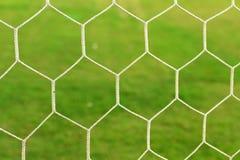 Предпосылка футбола цели яркая ая-зелен трава Стоковая Фотография