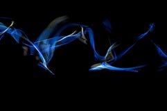 Предпосылка черноты и голубого свечения Стоковое фото RF