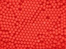 Предпосылка шариков Dragee - красный цвет Стоковые Изображения