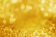 Предпосылка яркого блеска золота defocused Стоковое фото RF