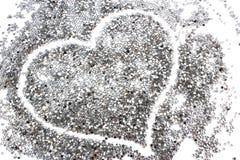 Предпосылка яркого блеска серебряная с сердцем Стоковые Фото