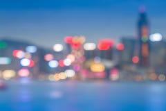 Предпосылка bokeh города светлая с отражением воды Стоковые Изображения