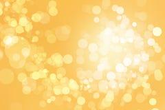 Предпосылка bokeh золота Стоковая Фотография