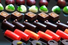 Предпосылка bonbons шоколада Стоковые Фото