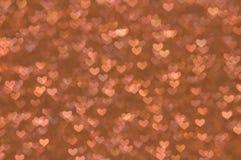 Предпосылка Defocused абстрактных сердец светлая Стоковые Фотографии RF
