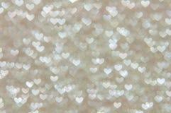 Предпосылка Defocused абстрактных сердец светлая Стоковая Фотография