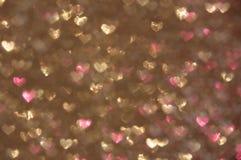 Предпосылка Defocused абстрактных сердец светлая Стоковая Фотография RF