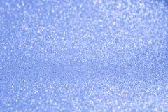 Предпосылка Glittery сияющих светов голубая абстрактная стоковое фото rf