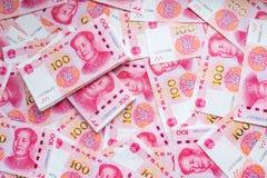 100 предпосылок банкноты фарфора Стоковая Фотография
