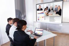 Предприниматели в видеоконференции Стоковые Фотографии RF