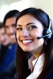 Предприниматели и коллеги в офисе центра телефонного обслуживания Стоковое Изображение