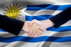 2 предприниматели и флага Уругвая Стоковая Фотография RF