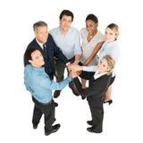 Предприниматели при штабелированные руки стоковое фото