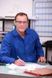 Предприниматель в офисе Стоковое Изображение RF