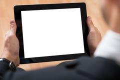 Предприниматель используя цифровую таблетку стоковое изображение