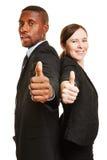 2 предпринимателя держа большие пальцы руки вверх Стоковые Фотографии RF