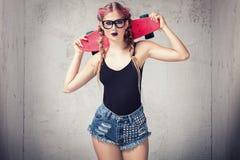 Представлять девушки конькобежца модный Стоковые Фотографии RF