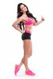 Представлять женщину красивого фитнеса сексуальную стоковая фотография