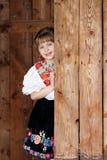 Представлять ребёнок в традиционном костюме Стоковые Изображения RF