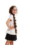 Представлять усмехаясь милую девушку в стеклах Стоковые Изображения