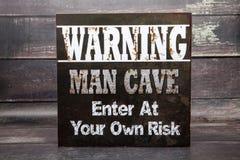Предупреждающая пещера человека Стоковые Изображения