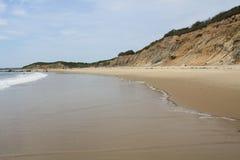 Прибой проползая вверх пляж Стоковое Изображение RF