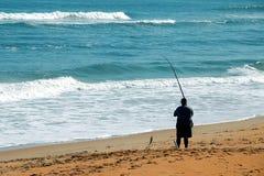 прибой рыболова стоковое изображение rf