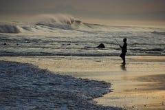 прибой рыболовства мальчика Стоковая Фотография RF