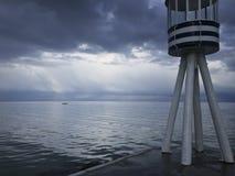 Прибрежные sculler и маяк стоковое изображение rf