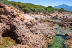 Прибрежный ландшафт с утесами и лагуной, Корсикой Стоковые Изображения RF