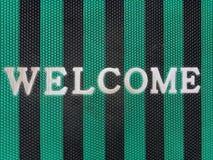 Приветственное сообщение на ткани стоковое изображение
